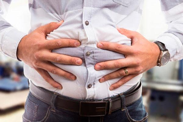 Вздутие живота: симптомы и виды лечения